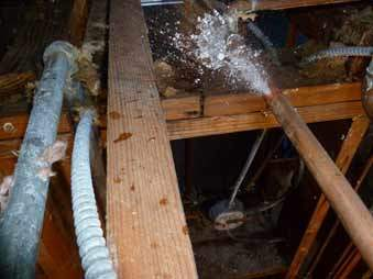 busted water pipe gushing water