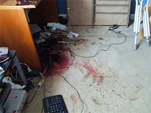 room in need of crime scene cleaning blood on floor